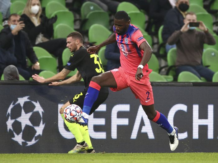 Krasnodars Marcus Berg, left, and Chelseas Antonio Rudiger challenge for the ball during the Champions League Group E soccer match between Krasnodar and Chelsea in Krasnodar, Russia, Wednesday, Oct. 28, 2020. (AP Photo)