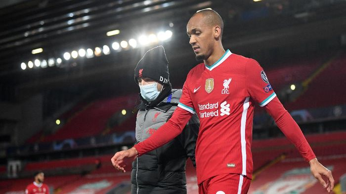 LIVERPOOL, ENGLAND - OCTOBER 27:  Fabinho of Liverpool walks around the pitch after he sustains an injury during the UEFA Champions League Group D stage match between Liverpool FC and FC Midtjylland at Anfield on October 27, 2020 in Liverpool, England. Sporting stadiums around the UK remain under strict restrictions due to the Coronavirus Pandemic as Government social distancing laws prohibit fans inside venues resulting in games being played behind closed doors. (Photo by Michael Regan/Getty Images)