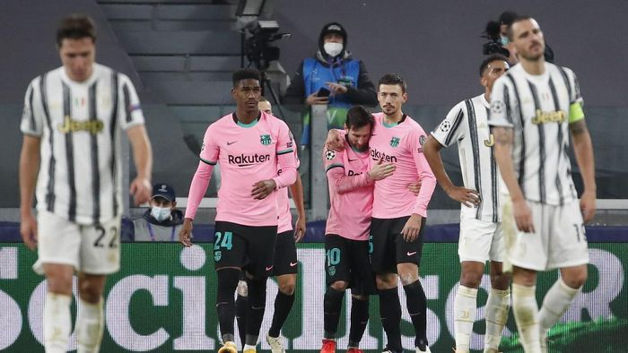 Barcelonas Lionel Messi, center, celebrates after scoring his sides second goal during the Champions League group G soccer match between Juventus and Barcelona at the Allianz stadium in Turin, Italy, Wednesday, Oct. 28, 2020. (AP Photo/Antonio Calanni)
