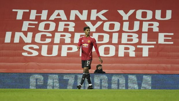 Manchester United's Marcus Rashford celebrates after scoring his side's second goal during the Champions League group H soccer match between Manchester United and RB Leipzig, at the Old Trafford stadium in Manchester, England, Wednesday, Oct. 28, 2020. (AP Photo/Dave Thompson)