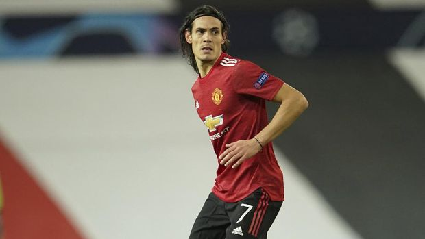 Manchester United's Edinson Cavani during the Champions League group H soccer match between Manchester United and RB Leipzig, at the Old Trafford stadium in Manchester, England, Wednesday, Oct. 28, 2020. (AP Photo/Dave Thompson)