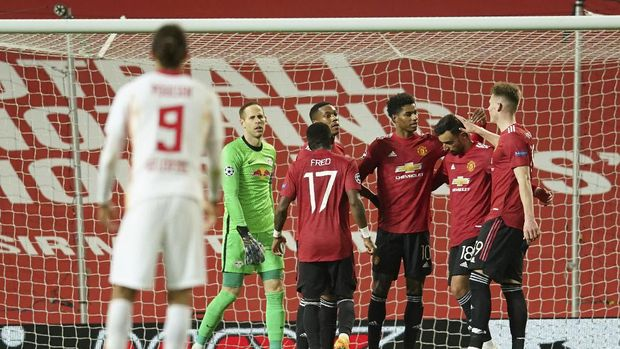 Manchester United's Marcus Rashford, third right, celebrates after scoring his side's fifth goal during the Champions League group H soccer match between Manchester United and RB Leipzig, at the Old Trafford stadium in Manchester, England, Wednesday, Oct. 28, 2020. (AP Photo/Dave Thompson)