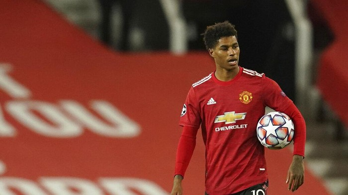 Manchester Uniteds Marcus Rashford walks end of the Champions League group H soccer match between Manchester United and RB Leipzig, at the Old Trafford stadium in Manchester, England, Wednesday, Oct. 28, 2020. (AP Photo/Dave Thompson)