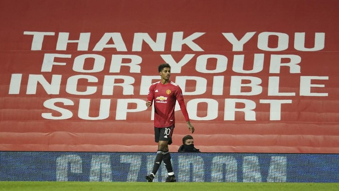 Manchester Uniteds Marcus Rashford celebrates after scoring his sides second goal during the Champions League group H soccer match between Manchester United and RB Leipzig, at the Old Trafford stadium in Manchester, England, Wednesday, Oct. 28, 2020. (AP Photo/Dave Thompson)