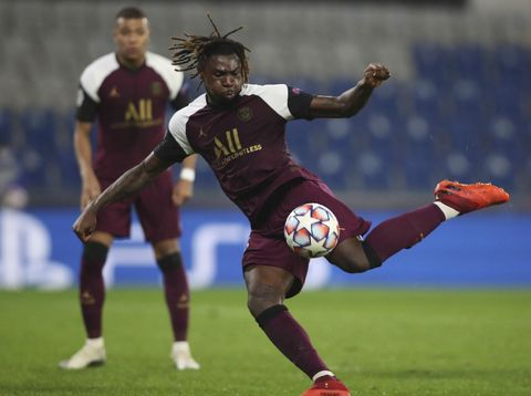 PSG's Moise Kean shoots to score his second goal during the Champions League group H soccer match between Basaksehir and Paris Saint Germain in Istanbul, Wednesday, Oct. 28, 2020. (Tolga Bozoglu/Pool via AP)