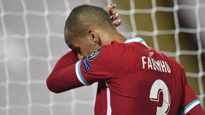 LIVERPOOL, ENGLAND - OCTOBER 27: Fabinho of Liverpool reacts after sustaining an injury during the UEFA Champions League Group D stage match between Liverpool FC and FC Midtjylland at Anfield on October 27, 2020 in Liverpool, England. Sporting stadiums around the UK remain under strict restrictions due to the Coronavirus Pandemic as Government social distancing laws prohibit fans inside venues resulting in games being played behind closed doors. (Photo by Peter Powell -