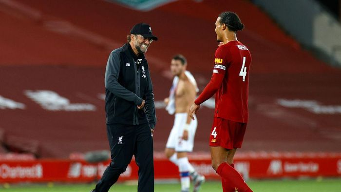LIVERPOOL, ENGLAND - JUNE 24: Jurgen Klopp, Manager of Liverpool celebrates with Virgil van Dijk of Liverpool after the Premier League match between Liverpool FC and Crystal Palace at Anfield on June 24, 2020 in Liverpool, England. (Phil Noble/Pool via Getty Images)
