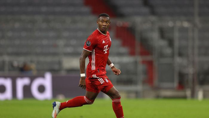 MUNICH, GERMANY - OCTOBER 21: David Alaba of FC Bayern München runs with the ball during the UEFA Champions League Group A stage match between FC Bayern Muenchen and Atletico Madrid at Allianz Arena on October 21, 2020 in Munich, Germany. (Photo by Alexander Hassenstein/Getty Images)