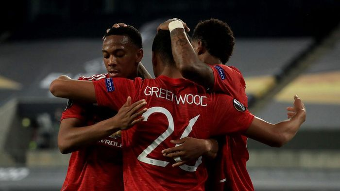 COLOGNE, GERMANY - AUGUST 10: Mason Greenwood of Manchester United celebrates with teammates Anthony Martial and Marcus Rashford after scoring a goal which is later disallowed during the UEFA Europa League Quarter Final between Manchester United and FC Kobenhavn at RheinEnergieStadion on August 10, 2020 in Cologne, Germany. (Photo by Wolfgang Rattay/Pool via Getty Images)