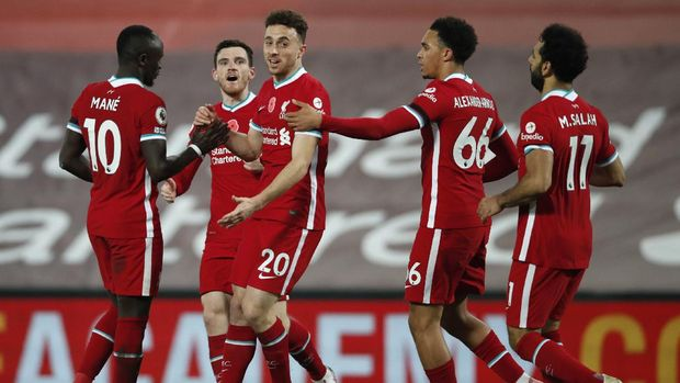 Liverpool's Diogo Jota, centre, celebrates scoring his sides second goal during the English Premier League soccer match between Liverpool and West Ham United at Anfield stadium in Liverpool, England, Saturday, Oct. 31, 2020. (Clive Brunskill/Pool via AP)