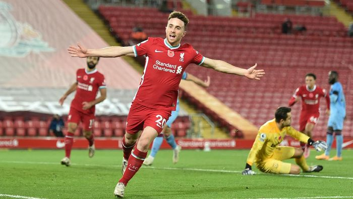 LIVERPOOL, ENGLAND - OCTOBER 31: Diogo Jota of Liverpool  celebrates after he scores his teams second goal  during the Premier League match between Liverpool and West Ham United at Anfield on October 31, 2020 in Liverpool, England. Sporting stadiums around the UK remain under strict restrictions due to the Coronavirus Pandemic as Government social distancing laws prohibit fans inside venues resulting in games being played behind closed doors. (Photo by Peter Powell - Pool/Getty Images)