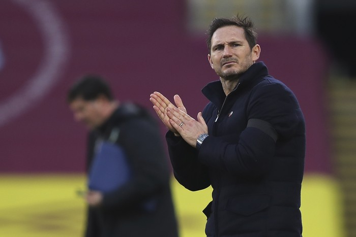Chelsea's head coach Frank Lampard applauds at half time during the English Premier League soccer match between Burnley and Chelsea at Turf Moor stadium in Burnley, England, Saturday, Oct. 31, 2020. (Molly Darlington/Pool via AP)
