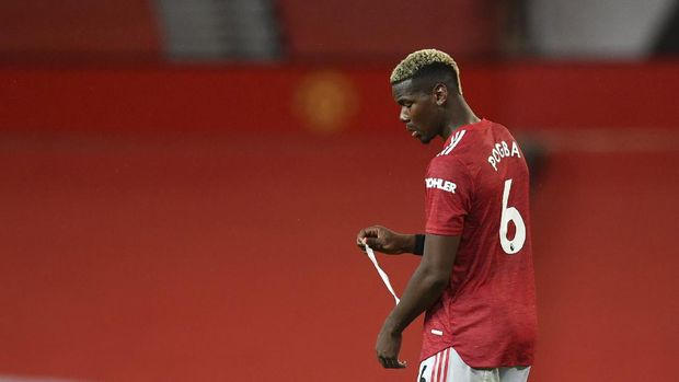 Manchester United's Paul Pogba walks in dejection end of the English Premier League soccer match between Manchester United and Arsenal at the Old Trafford stadium in Manchester, England, Sunday, Nov. 1, 2020. (Paul Ellis/Pool via AP)