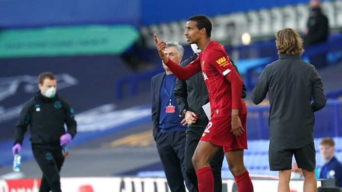 LIVERPOOL, ENGLAND - JUNE 21: Joel Matip of Liverpool reacts as he walks back on the pitch during the Premier League match between Everton FC and Liverpool FC at Goodison Park on June 21, 2020 in Liverpool, England. Football Stadiums around Europe remain empty due to the Coronavirus Pandemic as Government social distancing laws prohibit fans inside venues resulting in all fixtures being played behind closed doors. (Photo by Jon Super/Pool via Getty Images)
