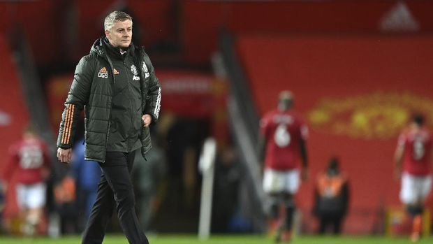 Manchester United's manager Ole Gunnar Solskjaer leaves the field end of the English Premier League soccer match between Manchester United and Arsenal at the Old Trafford stadium in Manchester, England, Sunday, Nov. 1, 2020. (Shaun Botterill/Pool via AP)