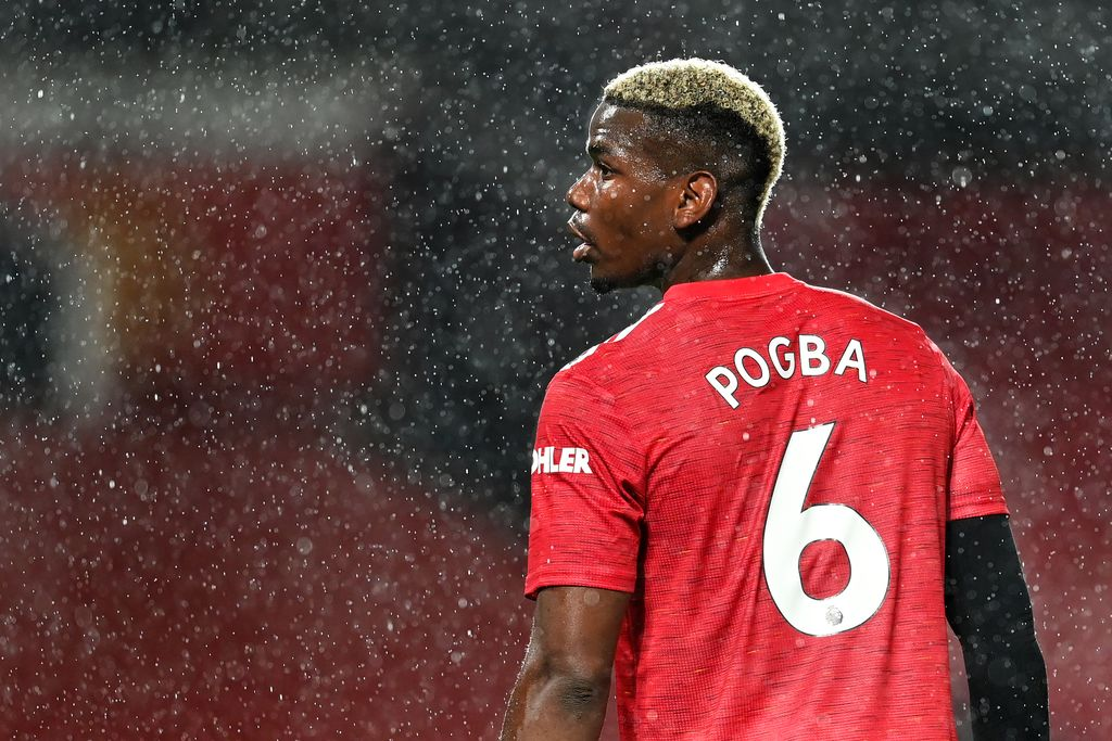 MANCHESTER, ENGLAND - OCTOBER 24: Paul Pogba of Manchester United looks on during the Premier League match between Manchester United and Chelsea at Old Trafford on October 24, 2020 in Manchester, England. Sporting stadiums around the UK remain under strict restrictions due to the Coronavirus Pandemic as Government social distancing laws prohibit fans inside venues resulting in games being played behind closed doors. (Photo by Michael Regan/Getty Images)
