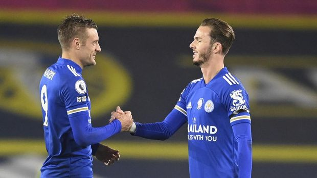 Leicester's James Maddison, right shakes hands with teammate Leicester's Jamie Vardy after the end of the English Premier League soccer match between Leeds United and Leicester City at Elland Road in Leeds, England, Monday, Nov. 2, 2020. Leicester won the game 4-1. (Michael Regan/Pool via AP)