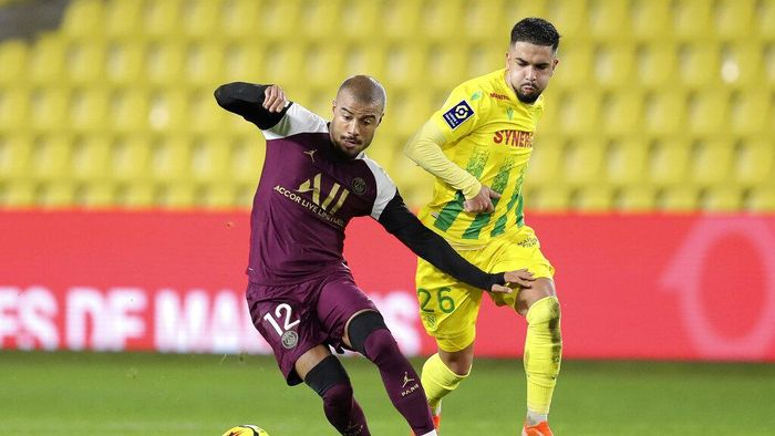 PSGs Rafinha, left, takes the ball away from Nantes Imran Louza during the French League One soccer match between Nantes and PSG at Stade de la Beaujoire in Nantes, France, Saturday, Oct. 31, 2020. (AP Photo/David Vincent)