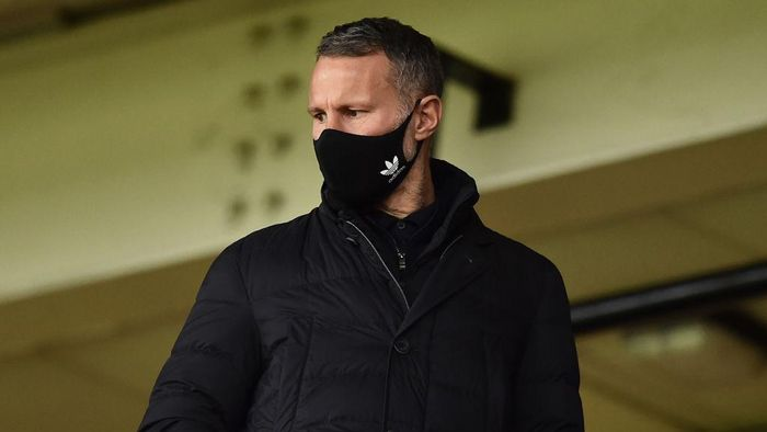 BURSLEM, ENGLAND - OCTOBER 17: Ryan Giggs co owner of Salford City and Wales manager look on in the stands during the Sky Bet League Two match between Port Vale and Salford City at Vale Park on October 17, 2020 in Burslem, England. Sporting stadiums around the UK remain under strict restrictions due to the Coronavirus Pandemic as Government social distancing laws prohibit fans inside venues resulting in games being played behind closed doors. (Photo by Nathan Stirk/Getty Images)