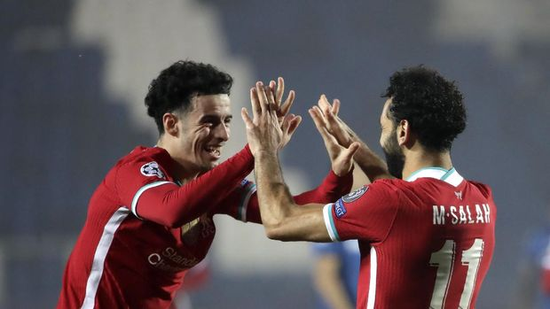 Liverpool's Mohamed Salah celebrates with his teammate Curtis Jones, his goal against Atalanta during the Champions League, group D soccer match between Atalanta and Liverpool, at the Gewiss Stadium in Bergamo, Italy, Tuesday, Nov. 3, 2020. (AP Photo/Luca Bruno)