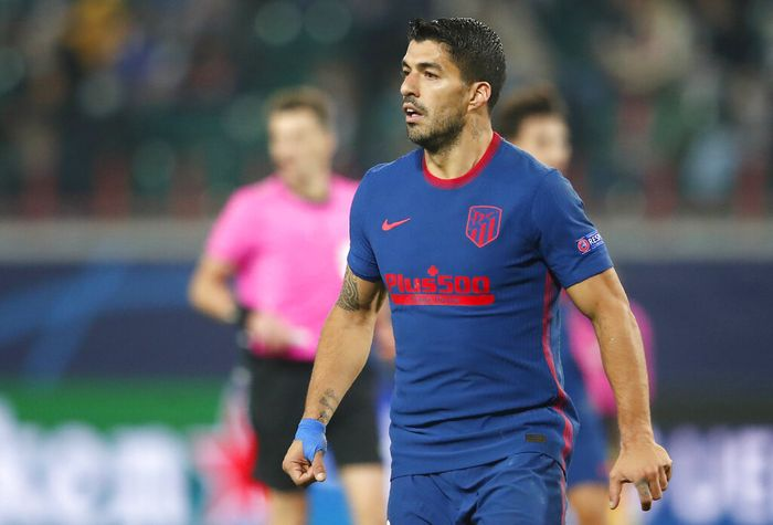 Atletico Madrids Luis Suarez during the Champions League Group A soccer match between Lokomotiv Moscow and Atletico Madrid in Moscow, Russia, Tuesday, Nov. 3, 2020. (Maxim Shemetov/Pool via AP)