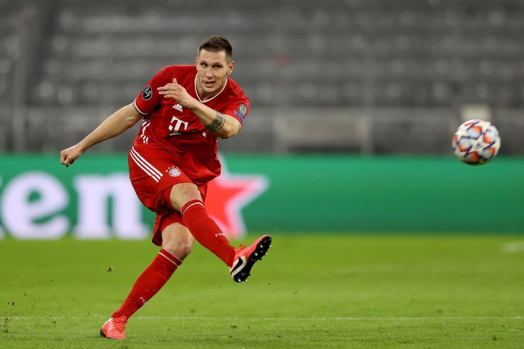 MUNICH, GERMANY - OCTOBER 21: Niklas Süle of FC Bayern München runs with the ball during the UEFA Champions League Group A stage match between FC Bayern Muenchen and Atletico Madrid at Allianz Arena on October 21, 2020 in Munich, Germany. (Photo by Alexander Hassenstein/Getty Images)