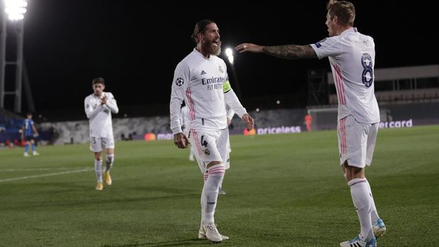 Real Madrid's Sergio Ramos, center, after scoring his side's second goal during the Champions League group B soccer match between Real Madrid and Inter Milan at the Alfredo Di Stefano stadium in Madrid, Spain, Tuesday, Nov. 3, 2020. (AP Photo/Bernat Armangue)