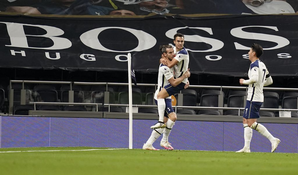Tottenham's Gareth Bale, left, is congratulated by teammates Sergio Reguilon and Son Heung-min, right, after scoring his team's second goal during the English Premier League soccer match between Tottenham Hotspur and Brighton & Hove Albion at Tottenham Hotspur Stadium, London, Sunday, Nov. 1, 2020. (John Walton/Pool via AP)