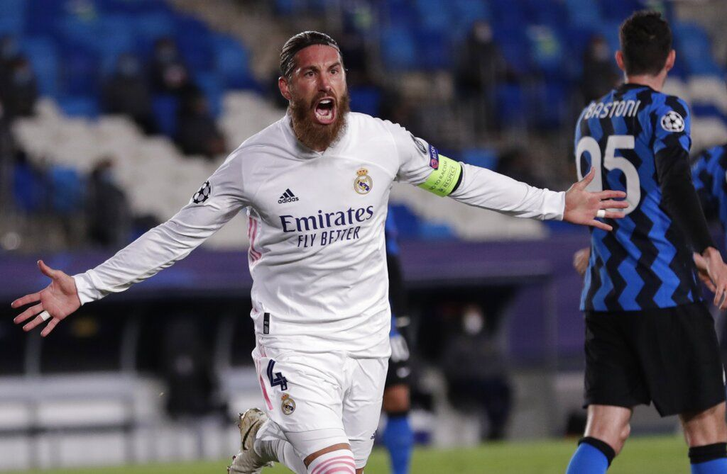 Real Madrid's Sergio Ramos celebrates after scoring his side's second goal during the Champions League group B soccer match between Real Madrid and Inter Milan at the Alfredo Di Stefano stadium in Madrid, Spain, Tuesday, Nov. 3, 2020. (AP Photo/Bernat Armangue)