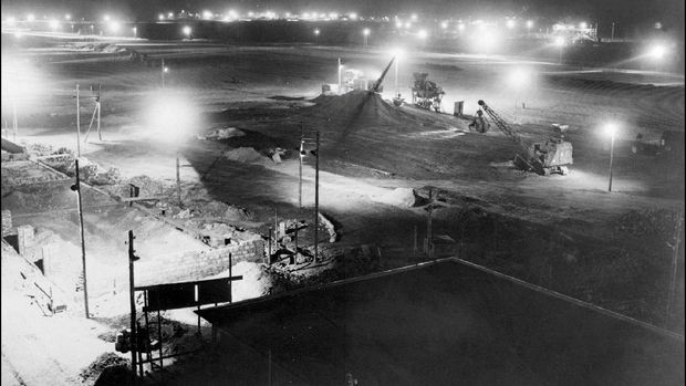 (FILES) This file photo taken on November 11, 1948 shows a general view of construction works at the Berlin Tegel airport in the french zone, ordered by the French Military authority for the Berlin airlift during the blockade. - Drab and outdated but beloved for its convenience and quirky hexagonal design, Berlin's Tegel airport will finally close for good on Sunday, November 8, 2020, after more than 60 years. (Photo by - / AFP)