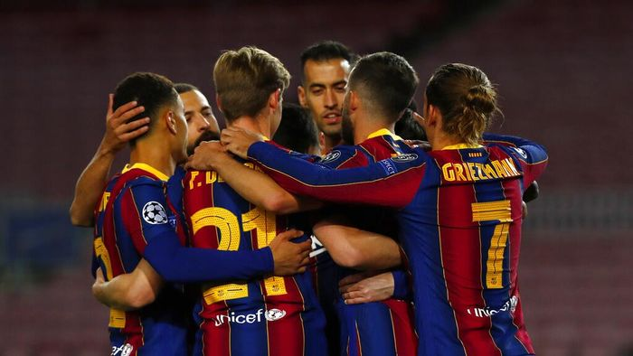 Barcelonas Lionel Messi celebrates with teammates after scoring from a penalty kick during the Champions League group G soccer match between FC Barcelona and Dynamo Kyiv at the Camp Nou stadium in Barcelona, Spain, Wednesday, Nov. 4, 2020. (AP Photo/Joan Monfort)