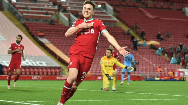 LIVERPOOL, ENGLAND - OCTOBER 31: Diogo Jota of Liverpool  celebrates after he scores his team's second goal  during the Premier League match between Liverpool and West Ham United at Anfield on October 31, 2020 in Liverpool, England. Sporting stadiums around the UK remain under strict restrictions due to the Coronavirus Pandemic as Government social distancing laws prohibit fans inside venues resulting in games being played behind closed doors. (Photo by Peter Powell - Pool/Getty Images)