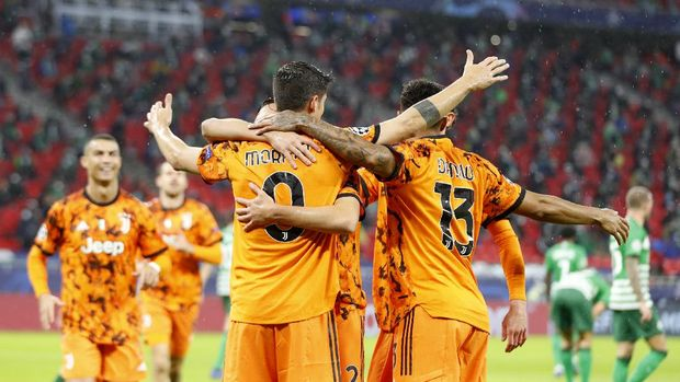Juventus' Alvaro Morata, center, celebrates after scoring the opening goal during the Champions League Group G soccer match between Ferencvaros and Juventus at the Puskas Arena in Budapest, Hungary, Wednesday, Nov. 4, 2020. (AP Photo/Laszlo Balogh)