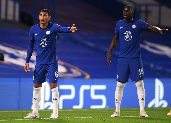 LONDON, ENGLAND - OCTOBER 20: Thiago Silva and Kurt Zouma of Chelsea gesture during the UEFA Champions League Group E stage match between Chelsea FC and FC Sevilla at Stamford Bridge on October 20, 2020 in London, England. Sporting stadiums around the UK remain under strict restrictions due to the Coronavirus Pandemic as Government social distancing laws prohibit fans inside venues resulting in games being played behind closed doors. (Photo by Mike Hewitt/Getty Images)