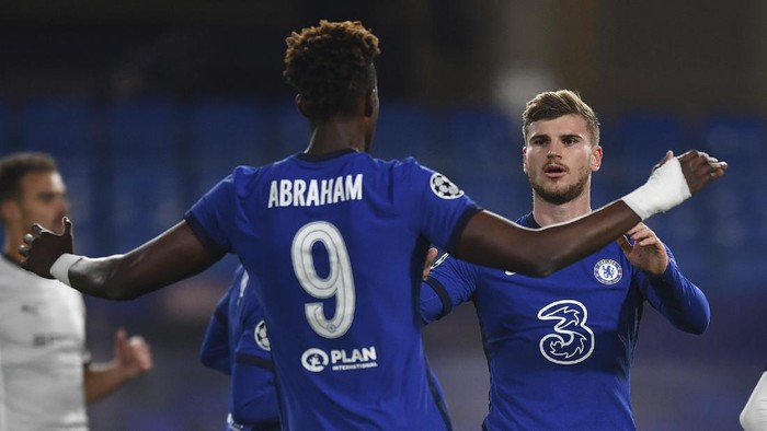Chelseas Timo Werner, right, celebrates after scoring the opening goal during the Champions League Group E soccer match between Chelsea and Rennes at Stamford Bridge, London, England, Wednesday Nov. 4, 2020. (Ben Stansall/Pool via AP)