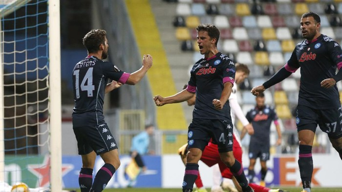 Napolis Diego Demme, centre, celebrates after scoring his sides opening goal during the Europa League Group F soccer match between Rijeka and Napoli at the Rujevica stadium in Rijeka, Croatia, Thursday, Nov. 5, 2020. (AP Photo/Darko Bandic)