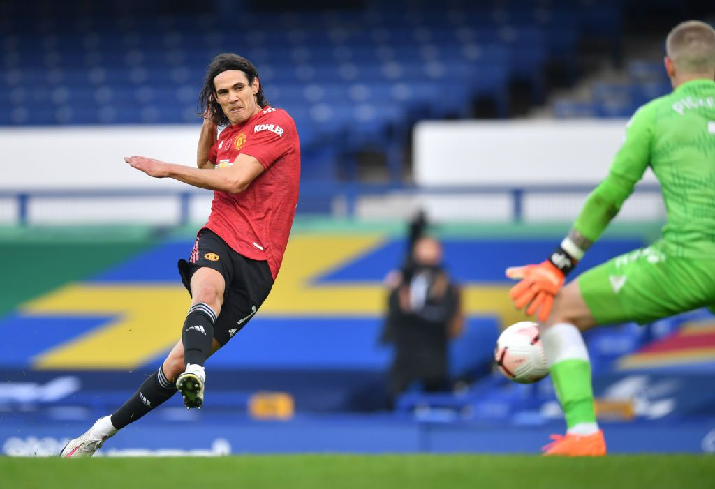 LIVERPOOL, ENGLAND - NOVEMBER 07: Edinson Cavani of Manchester United celebrates after scoring his team's third goal during the Premier League match between Everton and Manchester United at Goodison Park on November 07, 2020 in Liverpool, England. Sporting stadiums around the UK remain under strict restrictions due to the Coronavirus Pandemic as Government social distancing laws prohibit fans inside venues resulting in games being played behind closed doors. (Photo by Clive Brunskill/Getty Images)