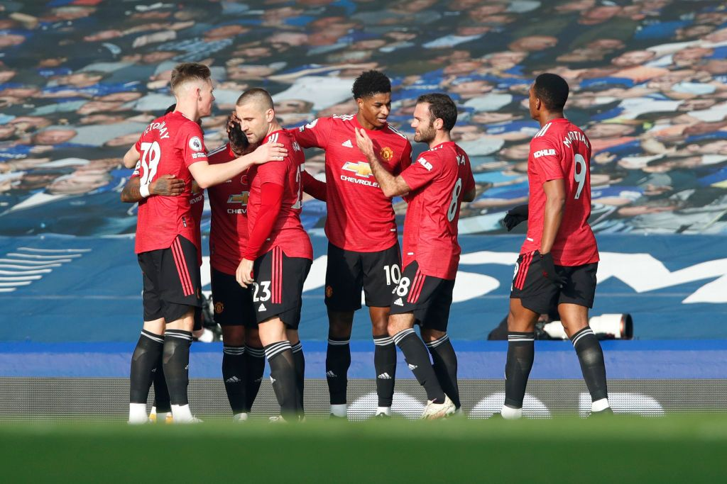 LIVERPOOL, ENGLAND - NOVEMBER 07: Bruno Fernandes of Manchester United celebrates with teammates after scoring his team's second goal during the Premier League match between Everton and Manchester United at Goodison Park on November 07, 2020 in Liverpool, England. Sporting stadiums around the UK remain under strict restrictions due to the Coronavirus Pandemic as Government social distancing laws prohibit fans inside venues resulting in games being played behind closed doors. (Photo by Clive Brunskill/Getty Images)