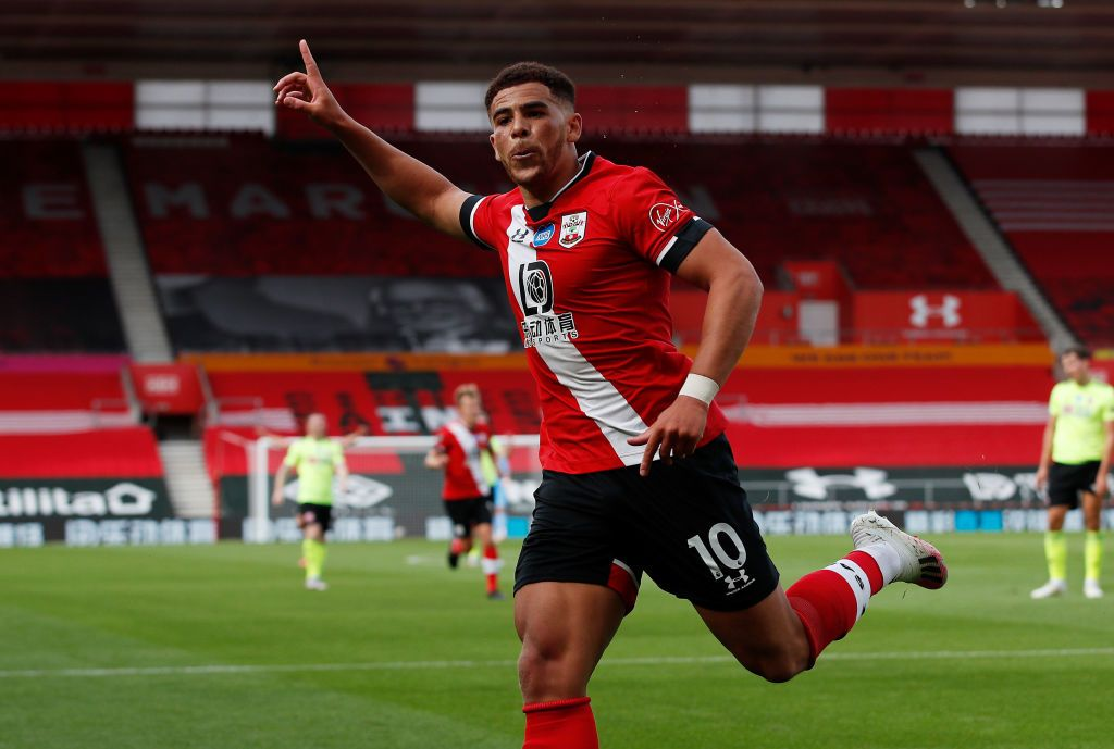 SOUTHAMPTON, ENGLAND - NOVEMBER 06: Southampton player  Che Adams celebrates his opening goal with Moussa Djenepo (l) during the Premier League match between Southampton and Newcastle United at St Mary's Stadium on November 06, 2020 in Southampton, England. Sporting stadiums around the UK remain under strict restrictions due to the Coronavirus Pandemic as Government social distancing laws prohibit fans inside venues resulting in games being played behind closed doors. (Photo by Stu Forster/Getty Images)