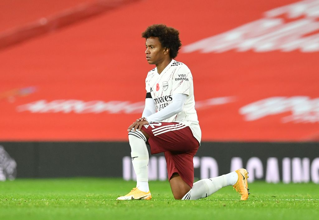 MANCHESTER, ENGLAND - NOVEMBER 01: Willian of Arsenal takes a knee in support of the Black Lives Matter movement prior to the Premier League match between Manchester United and Arsenal at Old Trafford on November 01, 2020 in Manchester, England. Sporting stadiums around the UK remain under strict restrictions due to the Coronavirus Pandemic as Government social distancing laws prohibit fans inside venues resulting in games being played behind closed doors. (Photo by Paul Ellis - Pool/Getty Images)