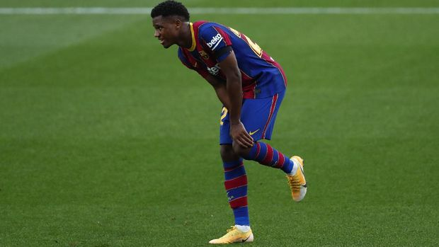 Barcelona's Ansu Fati, gestures after he was fouled by Betis' Aissa Mandi during the Spanish La Liga soccer match between FC Barcelona and Betis at the Camp Nou stadium in Barcelona, Spain, Saturday, Nov. 7, 2020. (AP Photo/Joan Monfort)