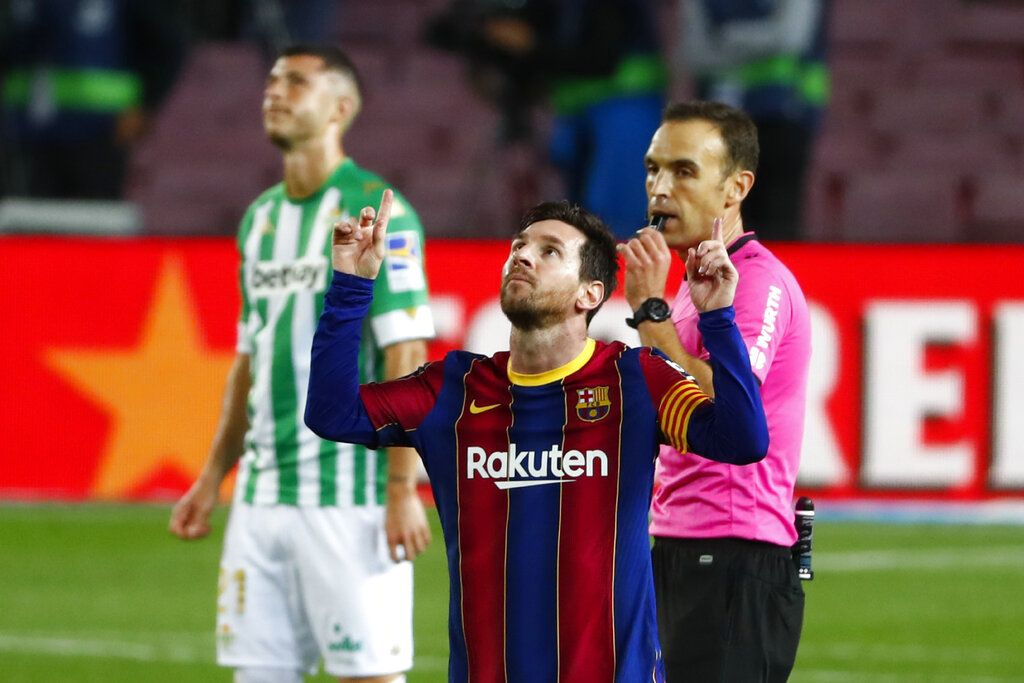 Barcelona's Lionel Messi celebrates after scoring his side's fourth goal during the Spanish La Liga soccer match between FC Barcelona and Betis at the Camp Nou stadium in Barcelona, Spain, Saturday, Nov. 7, 2020. (AP Photo/Joan Monfort)
