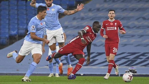 Liverpool's Sadio Mane is fouled for a penalty during the English Premier League soccer match between Manchester City and Liverpool at the Etihad stadium in Manchester, England, Sunday, Nov. 8, 2020. (Shaun Botterill/Pool via AP)