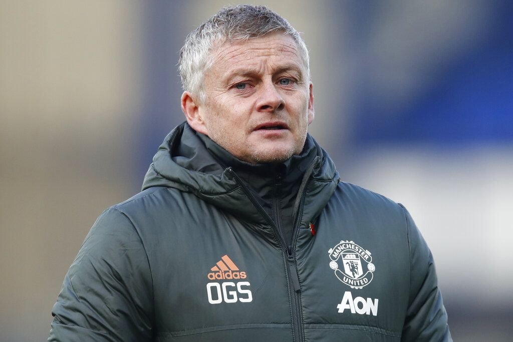 Manchester United's manager Ole Gunnar Solskjaer walks to the bench during the English Premier League soccer match between Everton and Manchester United at the Goodison Park stadium in Liverpool, England, Saturday, Nov. 7, 2020. (Clive Brunskill/Pool via AP)