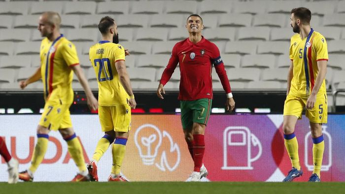 Portugals Cristiano Ronaldo, centre, reacts during the international friendly soccer match between Portugal and Andorra at the Luz stadium in Lisbon, Portugal, Wednesday, Nov. 11, 2020. (AP Photo/Armando Franca)