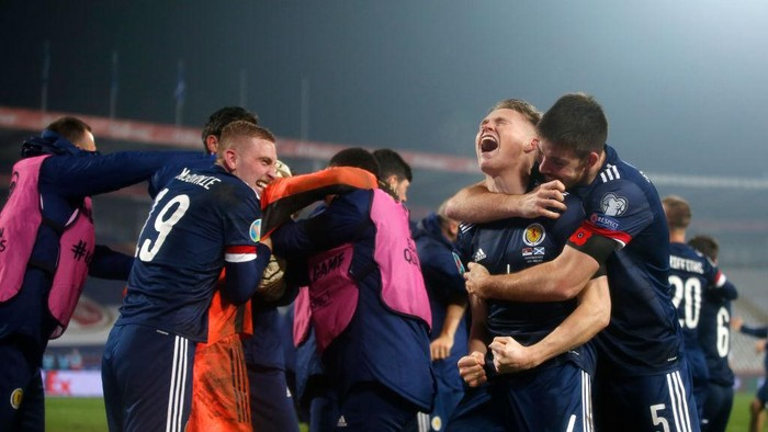BELGRADE, SERBIA - NOVEMBER 12: Scott McTominay of Scotland and Declan Gallagher of Scotland celebrate after the UEFA EURO 2020 Play-Off Final between Serbia and Scotland at Rajko Mitic Stadium on November 12, 2020 in Belgrade, Serbia. Football Stadiums around Europe remain empty due to the Coronavirus Pandemic as Government social distancing laws prohibit fans inside venues resulting in fixtures being played behind closed doors. (Photo by Srdjan Stevanovic/Getty Images)