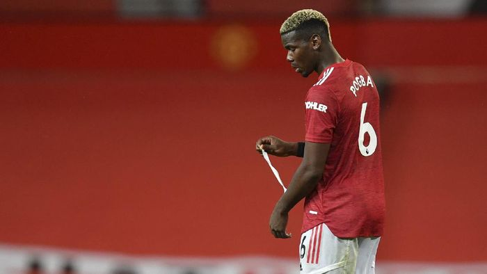 Manchester Uniteds Paul Pogba walks in dejection end of the English Premier League soccer match between Manchester United and Arsenal at the Old Trafford stadium in Manchester, England, Sunday, Nov. 1, 2020. (Paul Ellis/Pool via AP)