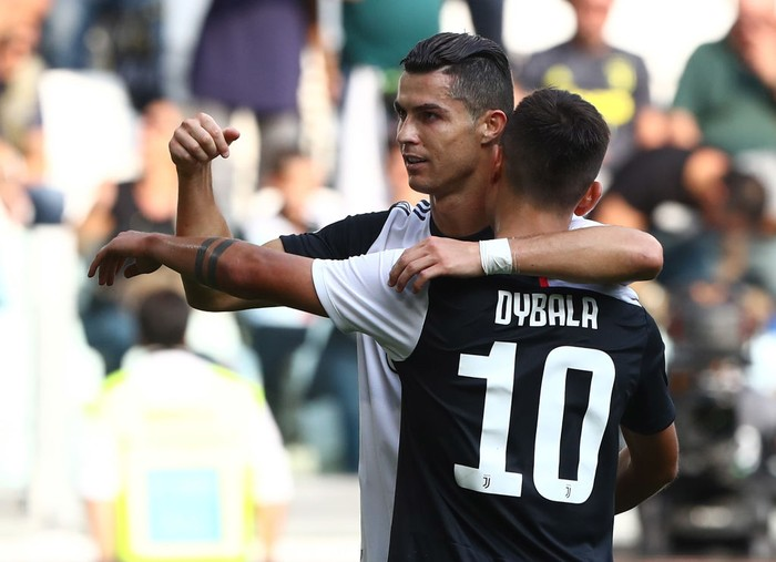TURIN, ITALY - SEPTEMBER 28:  Cristiano Ronaldo of Juventus FC celebrates his goal with his team-mate Paulo Dybala #10 during the Serie A match between Juventus and SPAL at Allianz Stadium on September 29, 2019 in Turin, Italy.  (Photo by Marco Luzzani/Getty Images)