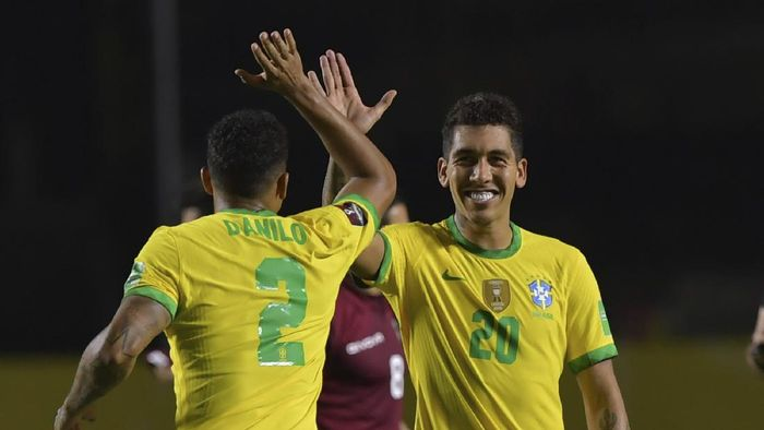 Brazils Roberto Firmino, right, celebrates with teammate Brazils Danilo after scoring his sides opening goal against Venezuela during a qualifying soccer match for the FIFA World Cup Qatar 2022 in Sao Paulo, Brazil, Friday, Nov.13, 2020. (Nelson Almeida/Pool via AP)