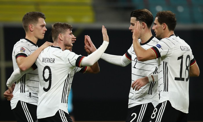 LEIPZIG, GERMANY - NOVEMBER 14: Timo Werner #9 of Germany celebrates his team's third goal with teammates  during the UEFA Nations League group stage match between Germany and Ukraine at Red Bull Arena on November 14, 2020 in Leipzig, Germany. (Photo by Maja Hitij/Getty Images)